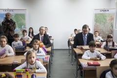 H.E. MICHAEL DAVENPORT (left) and PM ALEKSANDAR VUČIĆ sit at school desks