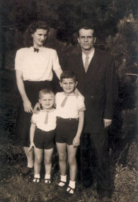 WITH HIS MOTHER, FATHER AND BROTHER FOLLOWING HIS FATHER'S RELEASE FROM PRISON IN 1954.