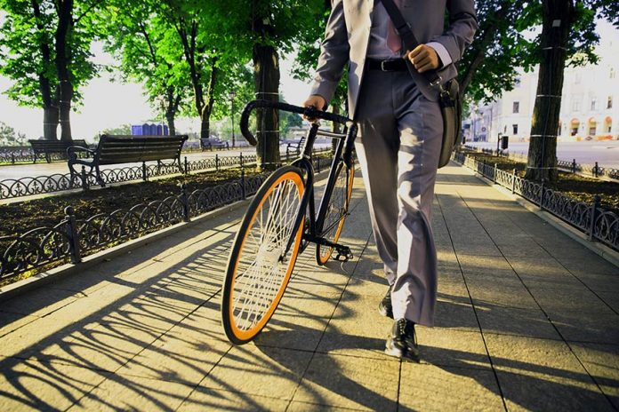 10 Facts About Workweek Around the World businessman with bike